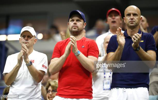 Coaches of Roger Federer of Switzerland Severin Luthi and Ivan Ljubicic applaud during his men's singles fourth round match against John Millman of...