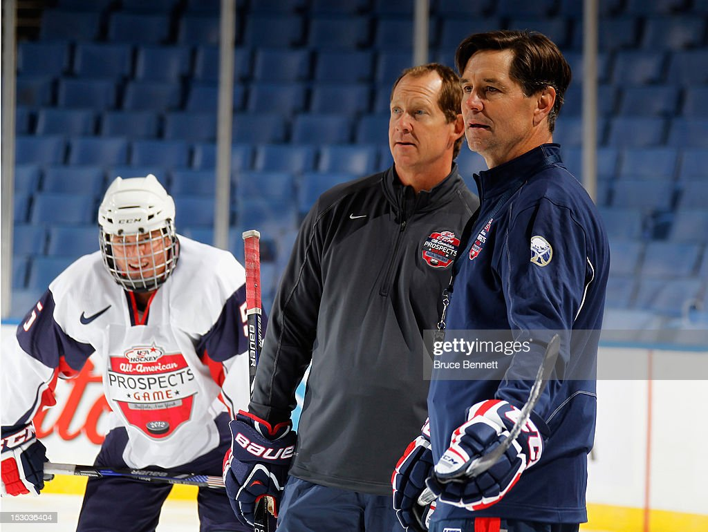 Coaches Phil Housley and Rob McClanahan oversee the morning skate prior to the USA Hockey All-American Prospects Game at the First Niagara Center on September 29, 2012 in Buffalo, New York.