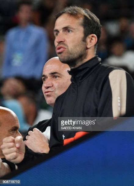 Coaches Radek Stepanek and Andre Agassi watch Serbia's Novak Djokovic play South Korea's Hyeon Chung during their men's singles fourth round match on...