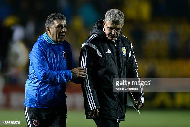 Coaches Ricardo 'Tuca' Ferretti of Tigres and Carlos Reinoso of Veracruz walk out the field at the end of a match between Tigres UANL and Veracruz as...
