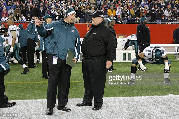 Coaches Rory Segrest and Andy Reid of the Philadelphia Eagles talk during the game against the New England Patriots on November 25 2007 at Gillette...