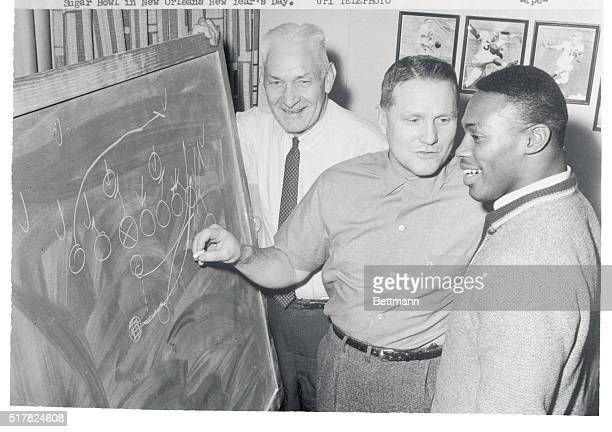 Coaches Roy Simmons and Dick Bell diagram a play with Syracuse star Floyd Little recently The Orangemen from Syracuse will oppose LSU in the Sugar...