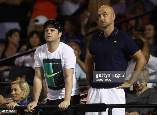 Coaches Severin Luthi and Ivan Ljubicic watch on as Roger Federer of Switzerland plays Nick Kyrgios of Australia in the semi finals at Crandon Park...