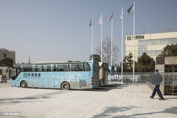 Coaches stand parked outside the ZhejiangHuahaiPharmaceutical Co Chuannan branch production base in Linhai Zhejiang Province China on Wednesday Jan...