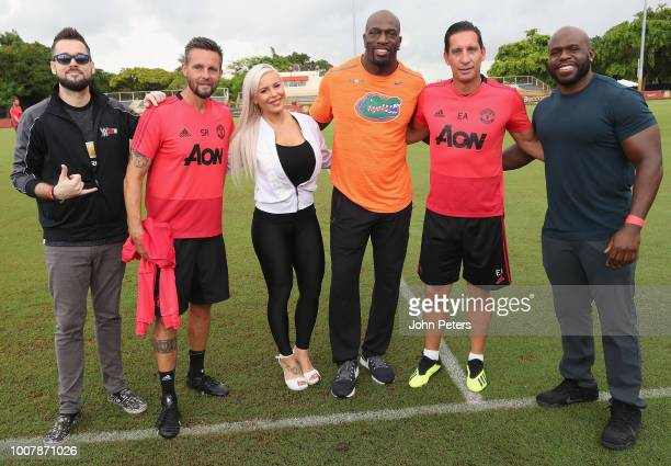 Coaches Stefano Rapetti and Emilio Alvarez of Manchester United pose with WWE announcer Mike Rome and wrestlers Apollo Crews, Dana Brooke and Titus...