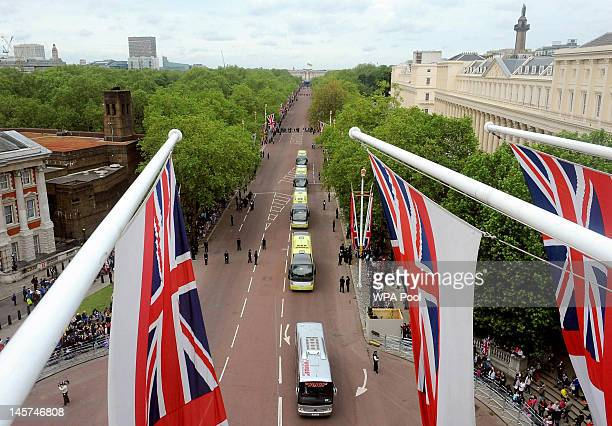 Coaches transport guests from Buckingham Palace along the Mall for a service of thanksgiving at St Paul's Cathedral on June 5 2012 in London England...