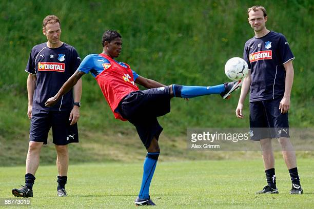 Coaches watch Maicosuel shoot a ball during a training session of 1899 Hoffenheim during a training camp on July 1, 2009 in Stahlhofen am Wiesensee,...