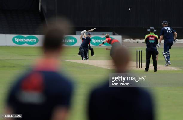 ECB coaches watch on as Ed Pollock of Warwickshire and the South smashes a boundary off the bowling of Jack Blatherwick of Nottinghamshire and the...