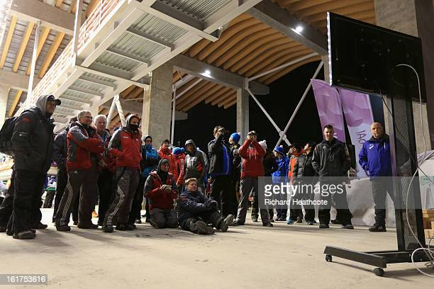 Coaches watch the action from the start house during the Women's Viessman FIBT Bob Skeleton World Cup at the Sanki Sliding Center in Krasnya Polyana...