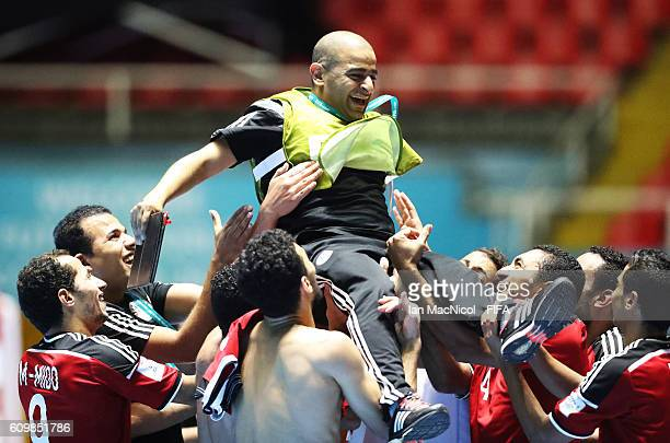 Coaching staff celebrates victory during the FIFA Futsal World Cup Round of 16 match between Italy and Egypt at the Coliseo el Pueblo Stadium on...