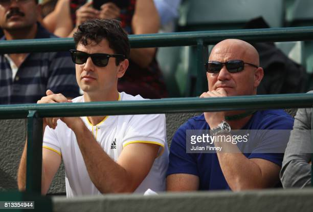 Coaching staff of Novak Djokovic Mario Ancic and Andre Agassi look on during his Gentlemen's Singles quarter final match against Tomas Berdych of The...