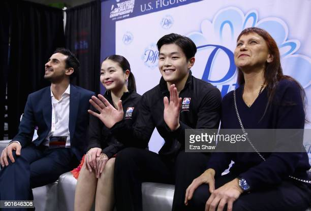 Coachs Massimo Scali and Marina Zueva waits for their score in the kiss and cry with Maia Shibutani and Alex Shibutani after they competed in the...