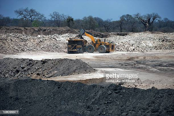 Coal brings boom to Mozambique's Tete cityPhoto dated on November 8 2010 shows a bulldozer loaing a dump truck in the Brazilian mining giant Vale...