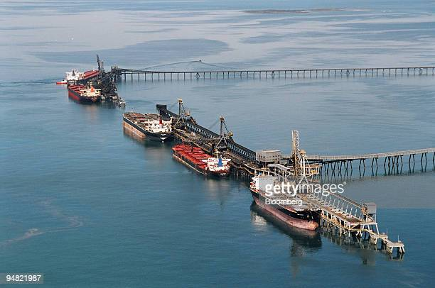 Coal carriers are loaded at the Hay Point and Dalrymple Bay Coal Terminal Jetties near Mackay Australia in this recent photo The queue of ships for...