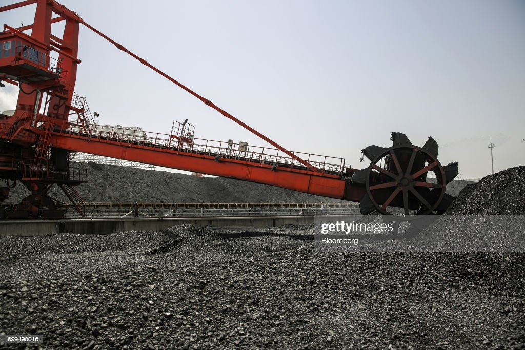 A coal dredger transfers coal from a storage area onto a conveyor at the Sahiwal coal power plant owned by China`s stateowned Huaneng Shandong Rui...