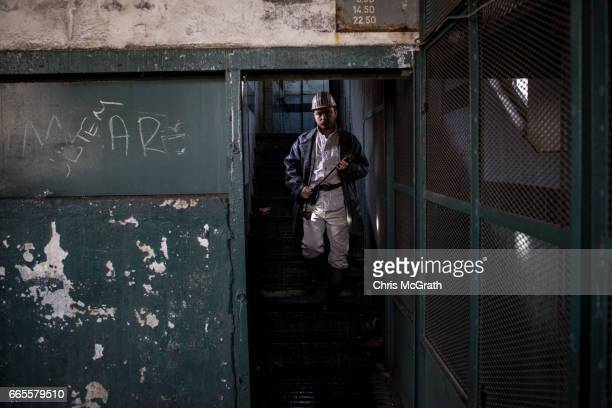 A coal engineer walks to an elevator to go underground at a large government run coal mine on April 4 2017 in Zonguldak Turkey More than 300...
