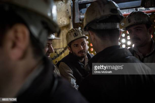 Coal engineers chat while taking an elevator underground at a large government run coal mine on April 4, 2017 in Zonguldak, Turkey. More than 300...