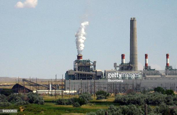 A coal fired power plant stands near Casper Wyoming US on Aug 13 2008 Ron Surdam once scoured Wyoming for energy reserves helping the least populous...