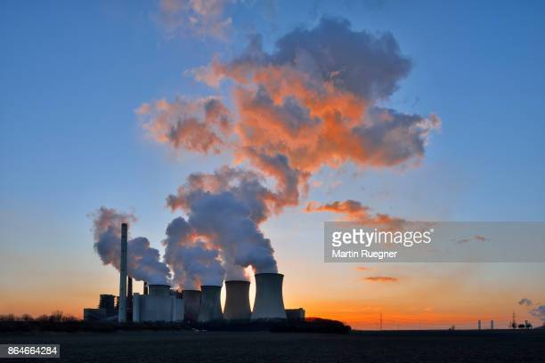 coal fired power station neurath i, backlight sunset. - coal fired power station stock pictures, royalty-free photos & images