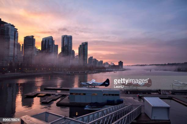 coal harbour at sunset, vancouver, canada - vancouver canada stock photos and pictures