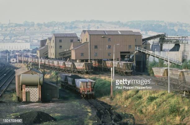 Coal hopper wagons await loading in railway sidings at a coal sorting plant at Derwenthaugh near Gateshead, England in 1987. The coal sorting plant...