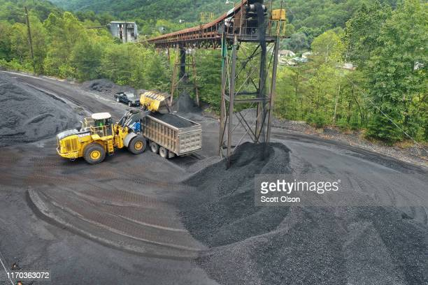 Coal is loaded onto a truck at a mine on August 26, 2019 near Cumberland, Kentucky. Eastern Kentucky, once littered with coal mines, is seeing that...