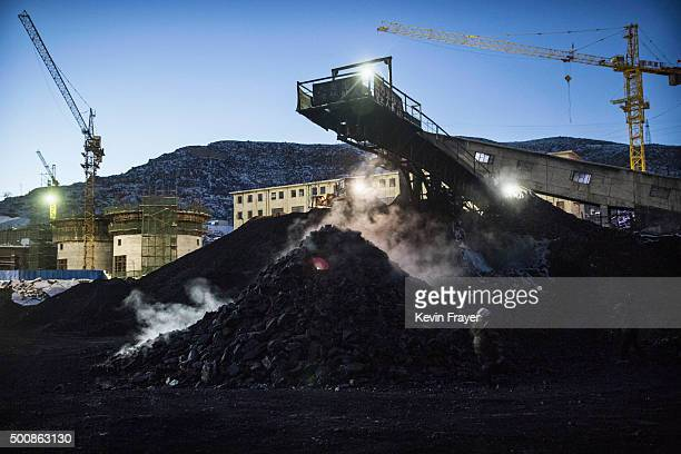 Coal is piled up as it is sorted at a coal mine on November 25 2015 in Shanxi China A history of heavy dependence on burning coal for energy has made...