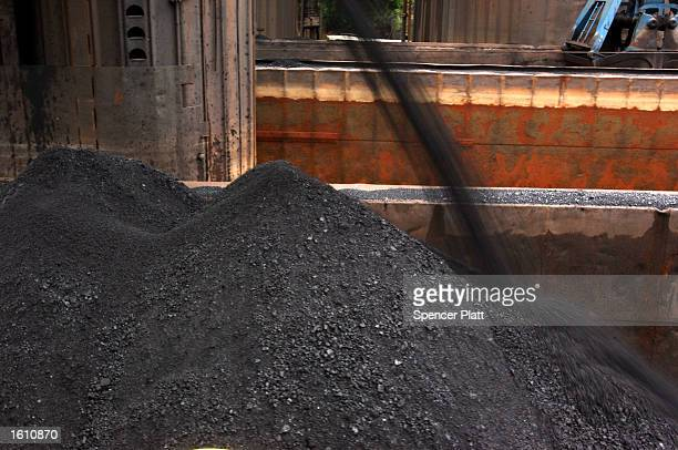 Coal is poured into a barge that will be moved to a steel plant August 26 2001 in western PA The coal mining industry once nearly extinct in...