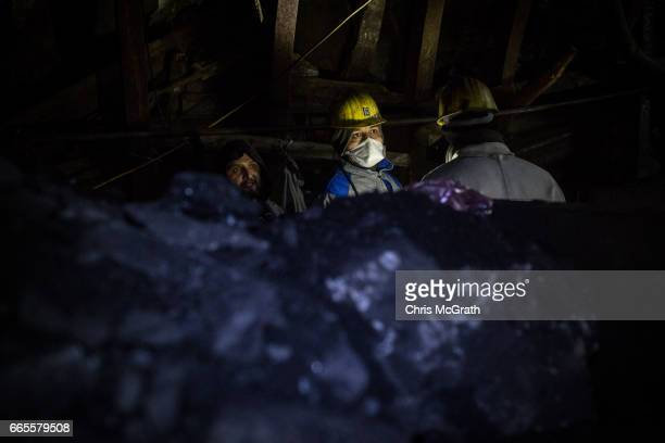 Coal is seen in front of coal miners at a large government run coal mine on April 4, 2017 in Zonguldak, Turkey. More than 300 kilometers of coal...
