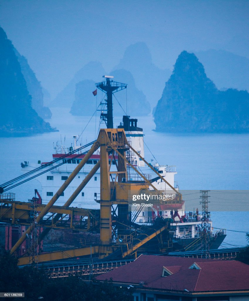 Coal loading to China in Cha Ong, Ha Long Bay : Stock Photo