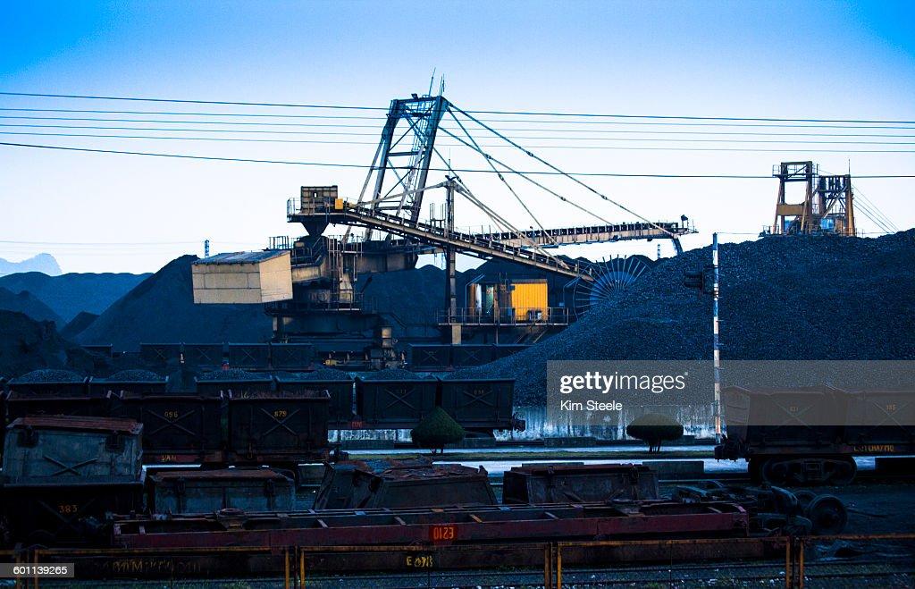 Coal loading to China in Cha Ong, Ha Long Bay : Stock Photo