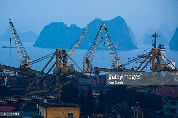 coal loading to china in cha ong, ha long bay - cha in ha stock photos and pictures