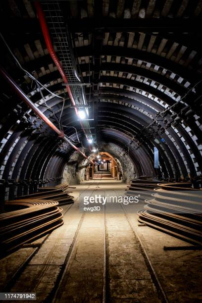 coal mine underground corridor with equipment - coal mine stock pictures, royalty-free photos & images