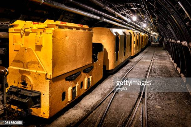 coal mine underground corridor with freight railroad cars - ruhr stock pictures, royalty-free photos & images