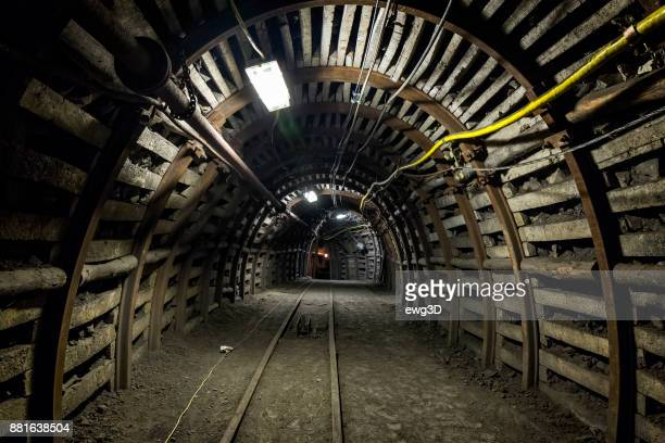coal mine underground corridor with railroad track - coal mine stock pictures, royalty-free photos & images