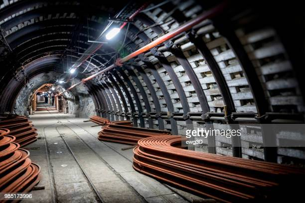 coal mine underground corridor with support system and  railroad tracks - silesia stock pictures, royalty-free photos & images