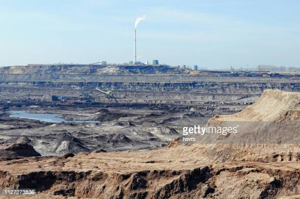 coal mine with bucket wheel excavator. air pollution. - archaeology stock pictures, royalty-free photos & images