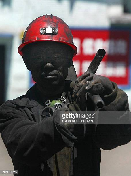 A coal miner finishes his shift at Ximing Mine a major stateowned mine on the western outskirts of Taiyuan 30 May 2004 capital of Shanxi China's...