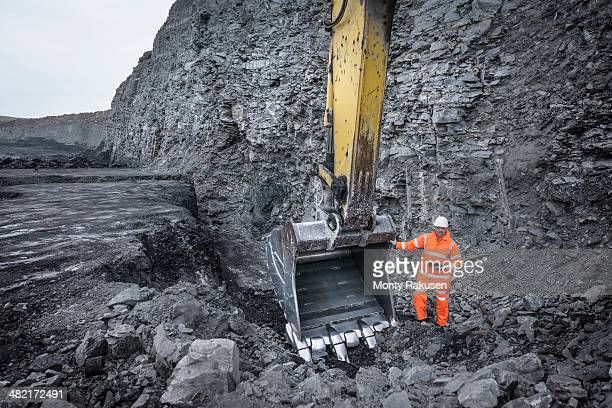 Coal miner inspects excavation in surface coal mine