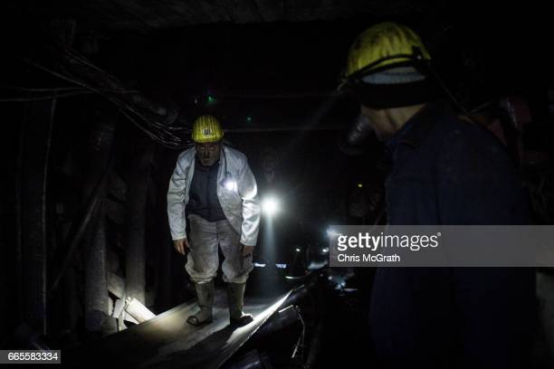 Coal miner is seen riding a conveyor belt towards the surface at a large government run coal mine on April 4, 2017 in Zonguldak, Turkey. More than...