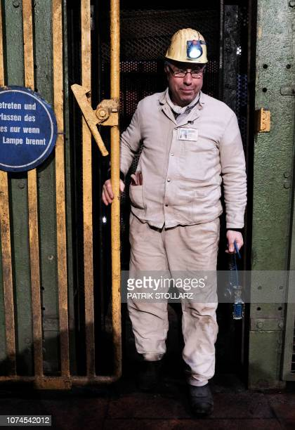 Coal miner Mehmet Kalyoncu leaves the elevator after the last piece of black coal was coaled at the Prosper Haniel colliery on December 21 2018 in...