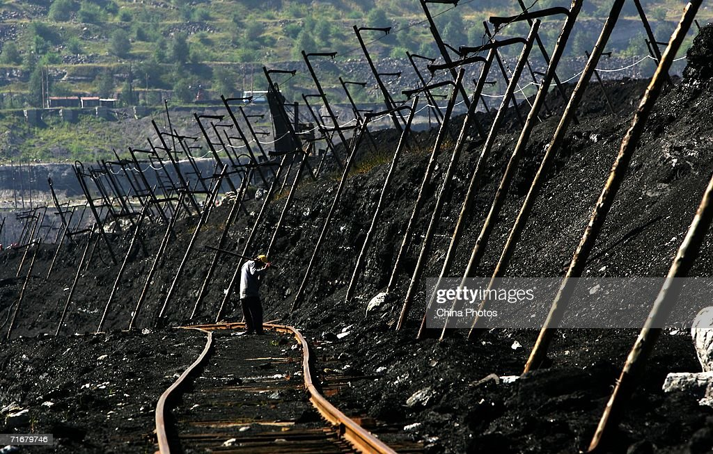 A coal miner monitors tracks in an open pit coal mine on August 19, 2006 in Chifeng of Inner Mongolia Autonomous Region, China. Pingzhuang Coal Groups Company, including six open pit coal mines, produces 10 million tons per year. Reportedly, in the first four months of this year, China's coal consumption rose by 13.8 percent over the same period of last year, and coal price is expected to go up steadily with the factors of environment, safety and resources included in the cost of coal production.