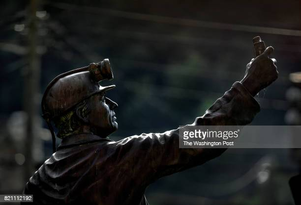 A coal miner statue stands permanently near the steps of the Boone County Courthouse entrance in MadisonWe look at the pronounced physical and...