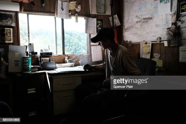 A coal miner takes a break after his shift at a small mine on May 19 2017 outside the city of Welch West Virginia West Virginia a state where...