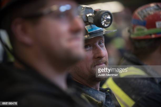 A coal miner waits for the arrival of US Environmental Protection Agency Administrator Scott Pruitt who visited with miners at the Harvey Mine on...