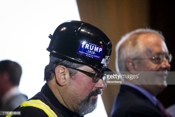 Coal miner wearing a 2020 campaign sticker for U.S. President Donald Trump arrives at Environmental Protection Agency headquarters in Washington,...