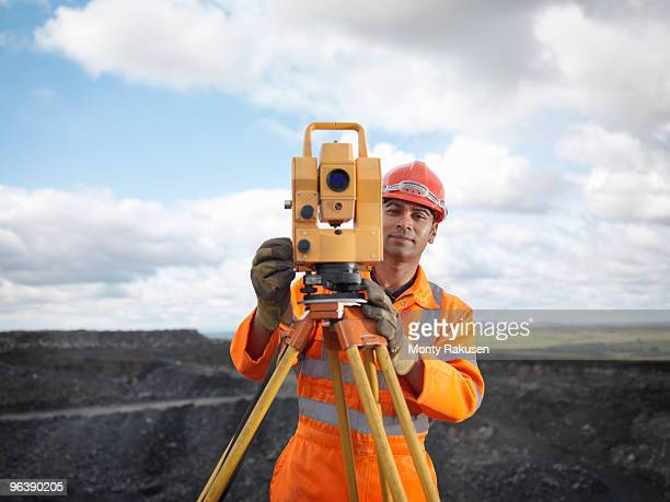 coal miner with surveying equipment - surveyor stock photos and pictures