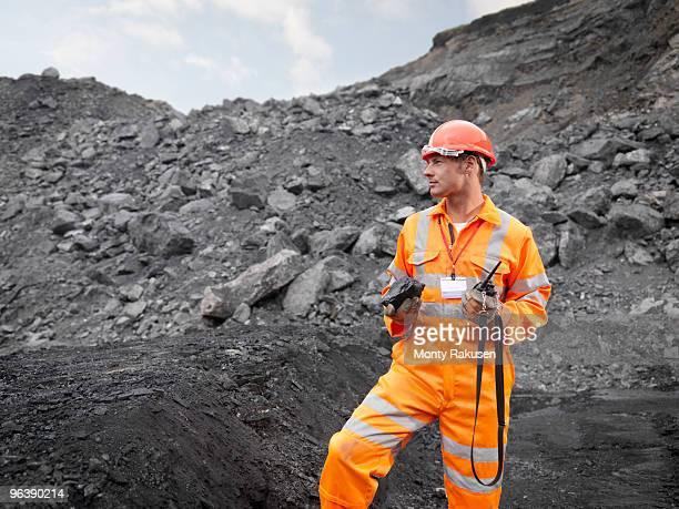 coal miner with walkie talkie - 鉱山労働者 ストックフォトと画像
