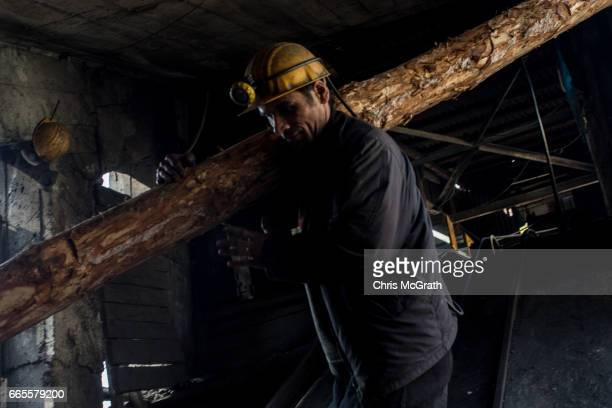 A coal miner works at the entrance to a mine shaft at a small mine on April 3 2017 in Zonguldak Turkey More than 300 kilometers of coal mineÕs riddle...