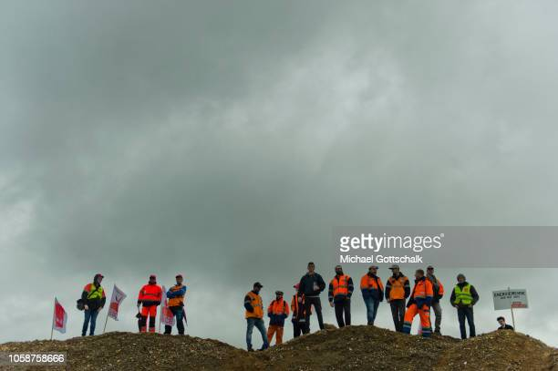 Coal miners and electricity plant workers of the RWE energy company stand on the edge of the demonstration on a mound of earth to demand a fair...